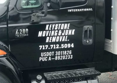 Image: Keystone Moving contact info shown on the truck door.