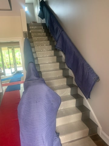 Pictured: moving pads on a staircase for protection during a move.