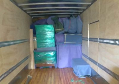 Image: A moving truck loaded with protected furniture.