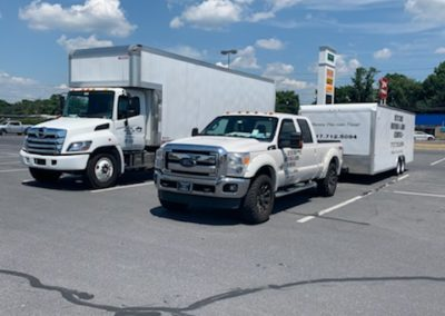 Image: Keystone Moving large moving truck and pickup with moving trailer.